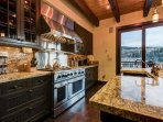 The spacious kitchen has stainless steel appliances and plenty of room to cook a great meal.