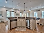 The spacious kitchen with island layout is perfect for cooking beachtime family meals together