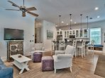 The open layout ensures that conversation will flow between kitchen and living room