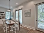 Mealtime is a family event with seating for 8 at the table plus 5 more at the breakfast bar
