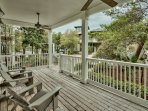Enjoy gulf breezes at day's end from the adirondack chairs on the front porch of Five SeaSons