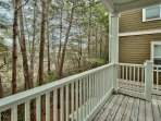 The back deck is attached to the mud room and the twin bedroom.