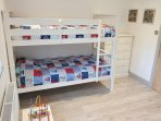 Kids bedroom with bunk beds and single bed, there is also a cot if required.