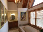 A huge spa tub and walk in shower. The picture wall is of  the Montecatini Spa in Italy. Rated PG.