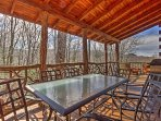 Rejuvenate on the covered deck that overlooks the sprawling forest.
