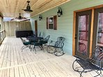 Relax in the hot tub or rockers on the covered porch overlooking the creek