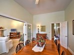Indulge in a home-cooked meal around this inviting dining room table.