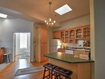 Prepare a tasty treat in this fully equipped kitchen and dine at the cozy breakfast bar.