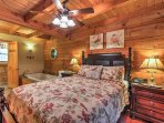 The main floor master suite has a comfortable queen-sized bed.