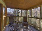 Lounge in style on the screened porch.