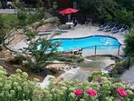 This community pool is open during the summer months and available for complimentary use.