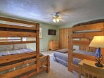 This bedroom features a twin-over-full and twin-over-queen bunk bed, great for children or friends sharing a room.