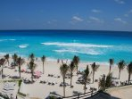 Our beach at Oleo Cancun Playa.  Yes, you have access to our resort loungers & little tents.
