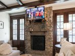 Den w/ wood fireplace and TV