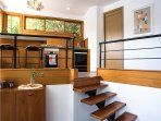 Steps up to the kitchen and walk-in pantry