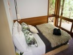 Fern bedroom leading to outdoor deck