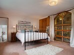 Master bedroom with stained glass window