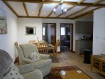 Open plan living, dining and kitchen area in a two bedroom cottage