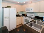 Fully equipped kitchen with recessed lighting, blender, 4-slice toaster