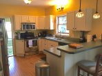 1st floor kitchen with updated appliances, service for 10+, many cooking tools, spices, etc.