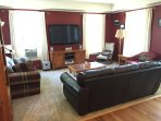 Living room off of entryway w/ window air conditioning, new carpet (2016), full cable plasma tv
