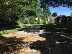 backyard with flagstone patio, dining area for 6 under huge maple tree