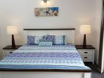 Gorgeous king bed with sunny outlook to balcony, ensuite adjoining room.