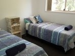 Comfortable single beds ca bed joined into a king bed, leafy outlook and large cupboard