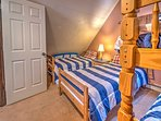 The kids' room has a twin-over-twin bunk bed and 2 other twin beds.