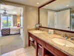 The master bath features a double granite vanity