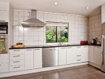 Spacious kitchen with modern facilities