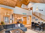 View of great room, kitchen and beautiful 20' vaulted cedar ceiling!