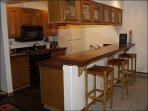 Fully equipped Kitchen with island seating.
