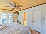 Slip into serenity in this airy master bedroom, complete with a ceiling fan and en suite bathroom.