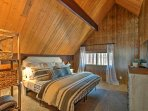 The loft leads to the master bedroom, where a king-sized bed ensures peaceful slumbers.