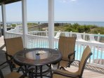 Covered Porch overlooking Ocean and Pool