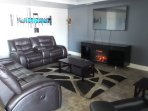 Living Room - 60' Smart Tv, Electric Fireplace with built-in sound system and bluetooth