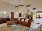 The large comfortable living room with generous and comfortable seating and flat screen TV.
