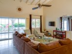 The living room opens to the upper lanai.