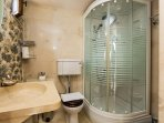The first residence features a bathroom with a glass shower cabin!