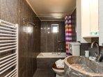The bathroom of the third residence is located on the ground floor and features an bathtub!