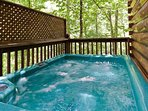 Right at the edge of the beautiful forest is your private hot tub.