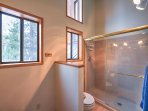 Rinse off after day at the bike park in this pristine walk-in shower.