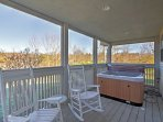 Enjoy the river views from your private balcony hot tub.