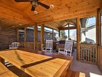 Enjoy the covered patio area, complete with a private jacuzzi, patio furniture and picnic table.