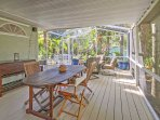 Gather around the outdoor dining table for a cup of coffee or a home-cooked meal.