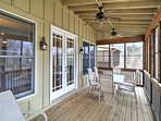 Enjoy morning coffee on the screened porch overlooking Lake Martin.
