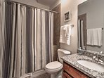 This full bathroom features a shower/tub and single vanity.