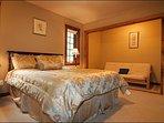 Bedroom with Cozy Queen Bed and Sleeper Sofa