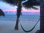 Nah Uxibal beach hammock at sunset